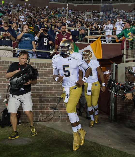 Oct. 18, 2014; Everett Golson (5) runs onto the field for warmups before the Florida State game. (Photo by Matt Cashore)