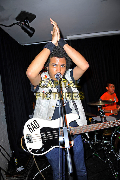 Isaiah Radke and Solomon Radke of Radkey <br /> performing in concert, The Blackeart, Camden, London, England. <br /> 17th October 2013<br /> on stage in concert live gig performance performing music half length white jean denim jacket sleeveless bass guitar orange top drums hands arms in air clapping<br /> CAP/MAR<br /> &copy; Martin Harris/Capital Pictures