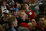 Supporters of Republican Presidential front runner Donald Trump react to protesters during his speech at the Synergy Flight Center in Bloomington, Illinois on March 13, 2016. Protests have become a regular feature of Donald Trump rallies, contributing in their way to the spectacle and circus-like environment.