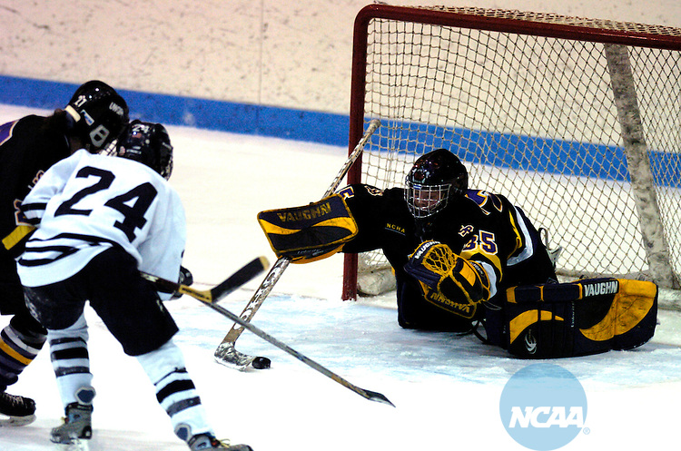 20 MAR 2004:  Amy Statz (35) of Wisconsin-Steven's Point dives for the puck while Shannon Sylvester (24) of Middlebury and Jennifer Norris (27) of Wisconsin Steven's Point fight for the puck during the Division 3 Women's Ice Hockey Championship held at Kenyon Arena on the campus of Middlebury College in Middlebury, VT.  Middlebury defeated Wisconsin-Steven's Point 2-1 for the championship title.  Jon Mahoney/NCAA Photos