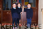 Rang 1 pupils Micheal, Ellie and Grainne from Scoil an Fheirtéaraigh by the school's old doors.