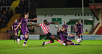 Lincoln City's John Akinde scores his side's second goal<br /> <br /> Photographer Chris Vaughan/CameraSport<br /> <br /> The Emirates FA Cup Second Round - Lincoln City v Carlisle United - Saturday 1st December 2018 - Sincil Bank - Lincoln<br />  <br /> World Copyright © 2018 CameraSport. All rights reserved. 43 Linden Ave. Countesthorpe. Leicester. England. LE8 5PG - Tel: +44 (0) 116 277 4147 - admin@camerasport.com - www.camerasport.com