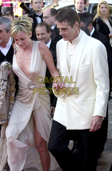 PATRICIA KAAS & JEREMY IRONS.Cannes Film Festival.holding hands, white jacket, plunging neckline, wrap dress, half length, half-length.www.capitalpictures.com.sales@capitalpictures.com.©Capital Pictures