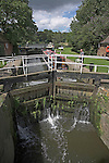 Canal narrow boat negotiating Fladbury Lock, River Avon, in the Vale of Evesham, England,