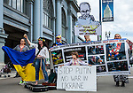 After the Ukrainian rally in Justin Herman Plaze in San Francisco, California on Sunday, March 9th, 2014, Julia Kosivchuk, of San Francisco, and other unidentified people moved over to the Ferry Building to sing and protest Putin's invasion of Ukraine. Photo/Victoria Sheridan
