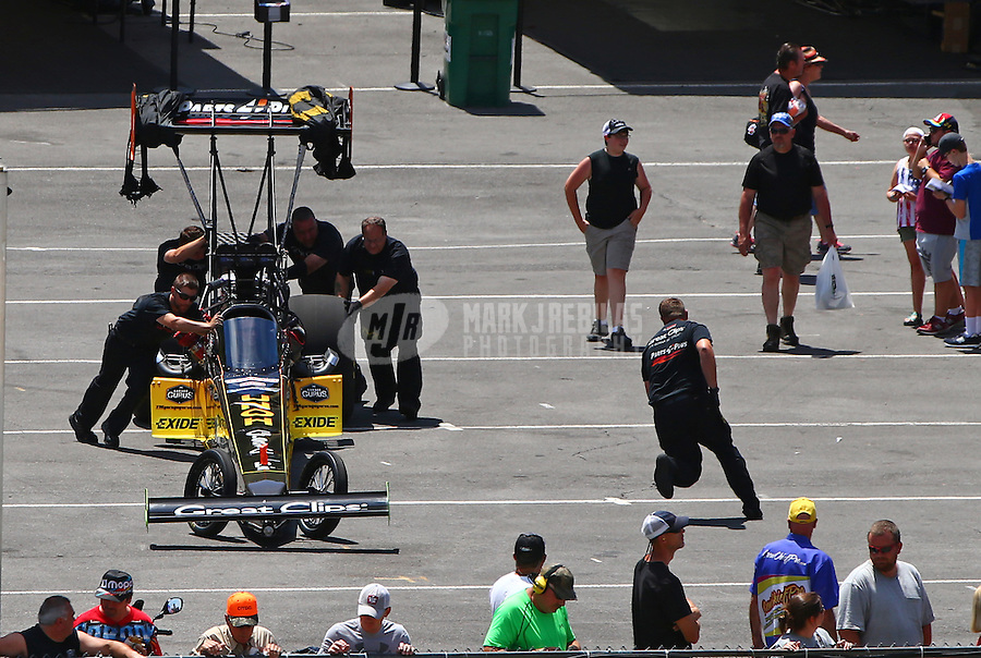 Jun 19, 2016; Bristol, TN, USA; Crew members with NHRA top fuel driver Clay Millican during the Thunder Valley Nationals at Bristol Dragway. Mandatory Credit: Mark J. Rebilas-USA TODAY Sports