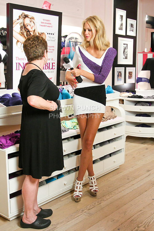 "Erin Heatherton interview sales staff during the ""Incredible by Victoria's Secret"" launch at the Victoria Secret SOHO Store, August 10, 2010."