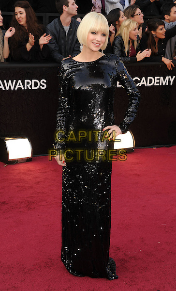 Anna Faris.Arrivals to the 84th Annual Academy Awards held at The Theatre at Hollywood & Highland Centre in Hollywood, California, USA. .February 26th, 2012.oscars full length dress black sequins sequined hand on hip .CAP/ROT/TM.©Tony Michaels/Roth Stock/Capital Pictures