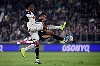 Juan Cuadrado of Juventus , Nicola Sansone of Bologna FC <br /> Torino 19/10/2019 Allianz Stadium <br /> Football Serie A 2019/2020 <br /> Juventus FC - Bologna <br /> Photo Federico Tardito / Insidefoto