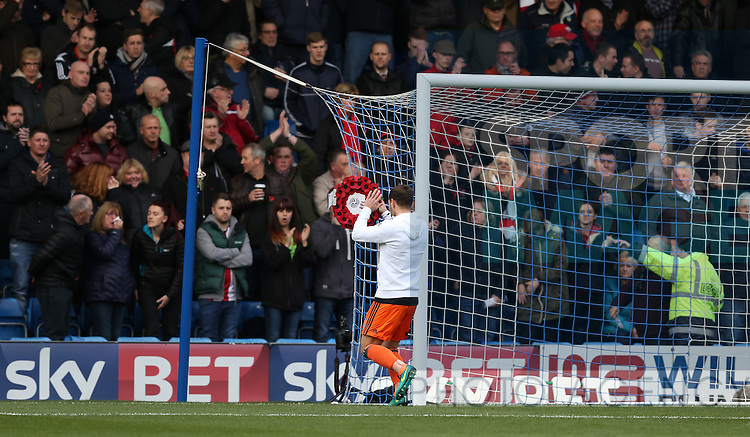 Billy Sharp of Sheffield Utd places the wreath behind the goal during the English League One match at the Proact Stadium, Chesterfield. Picture date: November 13th, 2016. Pic Simon Bellis/Sportimage