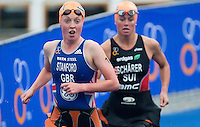 26 AUG 2012 - STOCKHOLM, SWE - Non Stanford  (GBR) of Great Britain (left) heads for transition at the end of her swim during the 2012 ITU Mixed Relay Triathlon World Championships in Gamla Stan, Stockholm, Sweden (PHOTO (C) 2012 NIGEL FARROW)