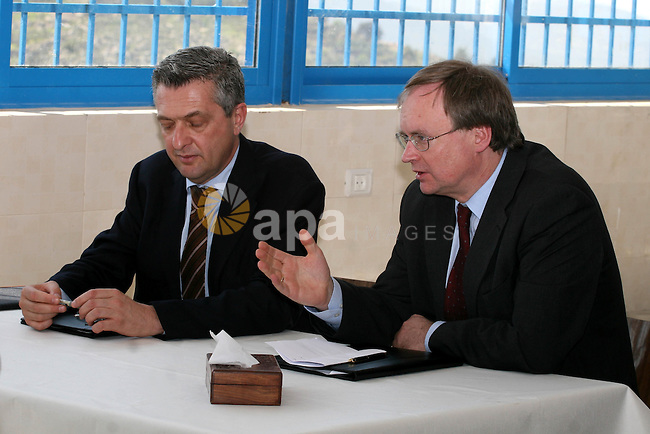 EU representative to the Palestinian Authority, Christian Berger and UNRWA Commissioner-General, Filippo Grandi sign an agreement with 40 million euros during a private visit to the village of Walajah near the West Bank city of Bethlehem on 21 March 2011. Photo by Issam Rimawi