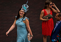 HALLANDALE BEACH, FL - JANUARY 27: A woman smiles and laughs as she exits the paddock on Pegasus World Cup Invitational Day at Gulfstream Park Race Track on January 27, 2018 in Hallandale Beach, Florida. (Photo by Scott Serio/Eclipse Sportswire/Getty Images)
