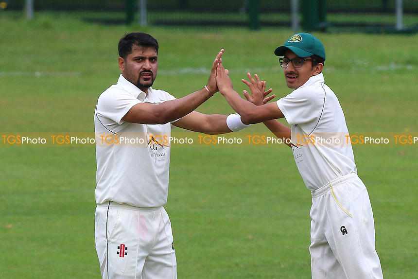 S Khan of Harold Wood celebrates taking the wicket of J Whetstone during Harold Wood CC (fielding) vs Upminster CC, Shepherd Neame Essex League Cricket at Harold Wood Park on 30th July 2016