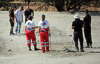 Pictured: Eddie Needham (TOP CENTRE), the grandfather of missing Ben Needham, is shown around the soil examination process by an officer in Kos, Greece. Wednesday 05 October 2016<br />