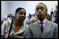 New York, USA. 23 August 2014. Esaw Garner, (L) speaks to Rev. Al Sharpton before a rally against police brutality in Staten Island.  Eduardo Munoz Alvarez/VIEWpress
