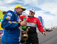 Feb 23, 2014; Chandler, AZ, USA; Runner-up V. Gaines (right) congratulates NHRA pro stock driver Allen Johnson who celebrates after winning the Carquest Auto Parts Nationals at Wild Horse Pass Motorsports Park. Mandatory Credit: Mark J. Rebilas-USA TODAY Sports