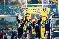 Mar 19, 2017; Gainesville , FL, USA; (from left) NHRA top fuel driver Tony Schumacher , pro stock motorcycle rider Eddie Krawiec, funny car driver John Force and pro stock driver Shane Gray celebrate after winning the Gatornationals at Gainesville Raceway. Mandatory Credit: Mark J. Rebilas-USA TODAY Sports