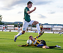 East Fife's Stevie Campbell clears from Hibs' Aaron Dunsmore.