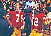 Washington Redskins offensive tackle Terry Hermeling (75) and wide receiver Charley Taylor (42) wait to be introduced with their teammates prior to the NFC Championship game against the Dallas Cowboys at RFK Stadium in Washington, DC on December 31, 1972.  The Redskins won the game and the right to play in Super Bowl VII by a score of 26 - 3.<br /> Credit: Arnie Sachs / CNP