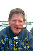 Fisherman age 55 happily smoking cigar on Gull Lake.  Nisswa  Minnesota USA