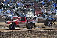 Apr 16, 2011; Surprise, AZ USA; LOORRS driver Dawson Kirchner (16) battles for position with Jason Ellis (89) and Ron Duncombe (4) during round 3 at Speedworld Off Road Park. Mandatory Credit: Mark J. Rebilas-.