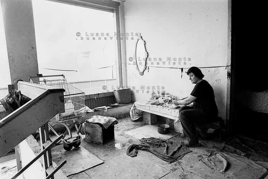 Immigrants without accommodation inhabit the abandoned areas of the city. Milan, 2001.