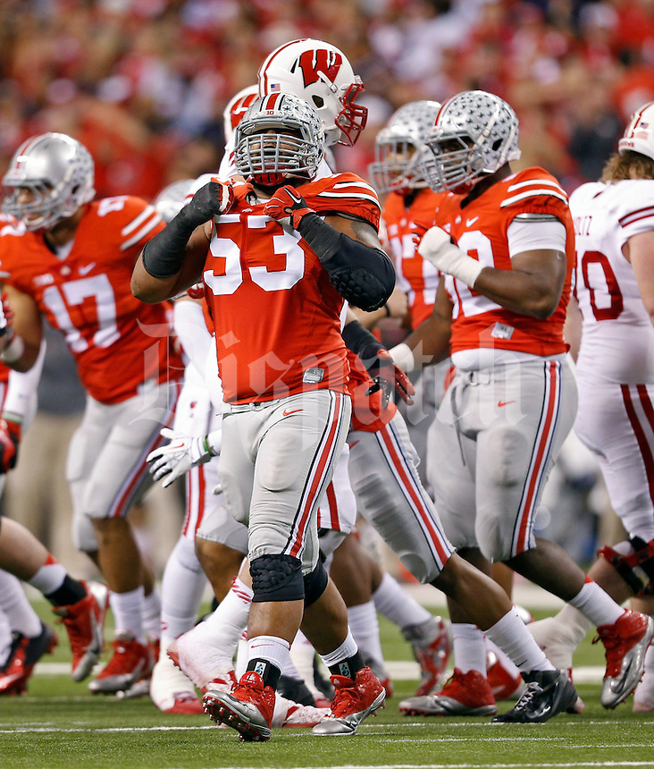Ohio State Buckeyes defensive tackle Michael Bennett (53) celebrates after a tackle against Wisconsin Badgers during the 1st quarter in the 2014 Big Ten Football Championship Game at Lucas Oil Stadium in Indianapolis, Ind. on December 6, 2014.  Bennett changed his number to honor the late Ohio State Buckeyes defensive lineman Kosta Karageorge (53) who past away last week.   (Dispatch photo by Kyle Robertson)