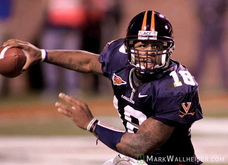 University of Virginia quarterback Marques Hagans (18) scramble against Florida State in Charlottesville, VA October 15, 2005.