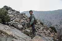 A soldier of the 4th Brigade of the 201. corps is climbing a mountain of Tora Bora to reach an advanced post where they can observe positions of Daesh. Last summer, Daesh arrived in the Nangarhar province but was quickly repulsed to the mountain range of Tora Bora where they are hiding. Tora Bora, Afghanistan, 14th November 2017.<br /> <br /> Un soldat de la 4ème brigade du 201 corps monte une montagne de Tora Bora pour atteindre un poste avancé où ils peuvent observer les positions de Daesh. L'été dernier, Daech est arrivé dans la province de Nangarhar mais a été rapidement repoussé dans la chaîne de montagnes de Tora Bora où ils se cachent. Tora Bora, Afghanistan, 14 novembre 2017.