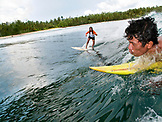 INDONESIA, Mentawai Islands, surfing a wave at Beng Beng