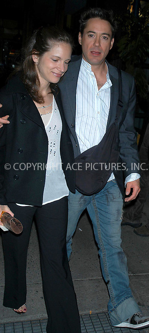 robert downey and fiancee out on town.   bocklet