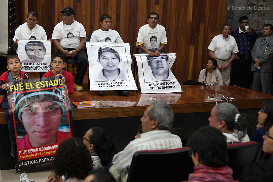 Parents and relatives of the 43 missing students from Ayotzinapa's teacher training college address medias and students to inform about the situation in Guerrero State during a conference at the University Center for Social Sciences and Humanities in Guadalajara, Jalisco, Mexico on November 18, 2014. The parents and relatives of the 43 missing students still do not believe the official line that the young men are all dead, and with classmates, social organizations and human rights defenders, they started on Thursday a national caravan. They split up into three different caravans, branching out to share information face to face with supporters in other cities and rally nationwide support. The three groups will meet in Mexico City on Thursday 20 for a general strike and massive marches to demand justice and fight against corrupted government and organized crime. Criticism of the government has intensified in Mexico, and many are demanding that the search for the 43 missing students continue until there is concrete evidence to the contrary. (Photo by BénédicteDesrus)