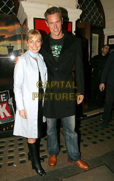 TERRI DWYER & MARK FOSTER.Jailhouse Rock - London Premiere.Picadilly Theatre, W1.April 19th, 2004.full length, full-length, blue scarf, blue jacket, coat, black boots.www.capitalpictures.com.sales@capitalpictures.com.© Capital Pictures.