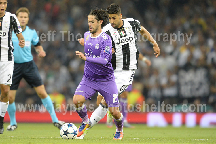 Isco of Real Madrid battles Sami Khedira of Juventus  during the UEFA Champions league final  between Juventus and Real Madrid at the National Stadium of Wales on Saturday 3rd June 2017<br /> <br /> <br /> Jeff Thomas Photography -  www.jaypics.photoshelter.com - <br /> e-mail swansea1001@hotmail.co.uk -<br /> Mob: 07837 386244 -