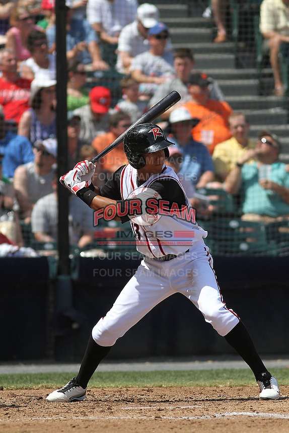 Richmond Flying Squirrels infielder Ehire Adrianza #13 at bat during a game against the Trenton Thunder at The Diamond on May 27, 2012 in Richmond, Virginia. Richmond defeated Trenton by the score of 5-2. (Robert Gurganus/Four Seam Images)
