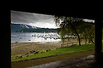 View of boats moored and people on the beach on a cloudy day. Deep Cove,Vancouver, British Columbia, Canada.