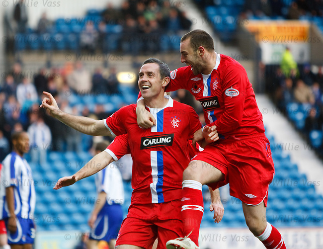 David Weir celebrates his goal with Kris Boyd