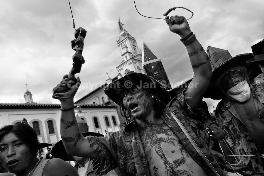 Indians, wearing military camouflage, dance furiously during the Inti Raymi (San Juan) festivities in Cotacachi, Ecuador, 29 June 2010. 'La toma de la Plaza' (Taking of the square) is an ancient ritual kept by Andean indigenous communities. From the early morning of the feast day, various groups of San Juan dancers from remote mountain villages dance in a slow trot towards the main square of Cotacachi. Reaching the plaza, Indians start to dance around. They pound in synchronized dance rhythm, shout loudly, whistle and wave whips, showing the strength and aggression. Dancers from either the upper communities (El Topo) or the lower communities (La Calera), joined in respective coalitions, seek to conquer and dominate the square and do not let their rivals enter. If not moderated by the police in time, the high tension between groups always ends up in violent clashes.