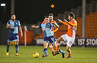 Luke O'Nien of Wycombe Wanderers under pressure from Michael Cain of Blackpool during the The Checkatrade Trophy match between Blackpool and Wycombe Wanderers at Bloomfield Road, Blackpool, England on 10 January 2017. Photo by Andy Rowland / PRiME Media Images.