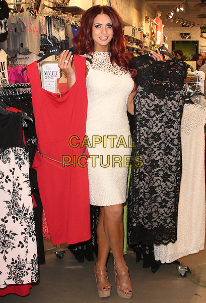 Amy Childs .at a Personal Appearance and Signing, Bank Fashion store in Bluewater Shopping centre, Greenhithe, Kent, UK,.April 27th 2013..full length flowers cut out white cream sleeveless  lace high neck dress brown tan strappy sandals platform wedges  holding up dresses clothes .CAP/JIL.©Jill Mayhew/Capital Pictures..