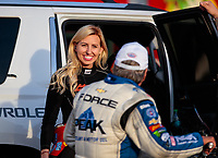 Oct 12, 2018; Concord, NC, USA; NHRA funny car driver Courtney Force (left) talks with father John Force during qualifying for the Carolina Nationals at zMax Dragway. Mandatory Credit: Mark J. Rebilas-USA TODAY Sports