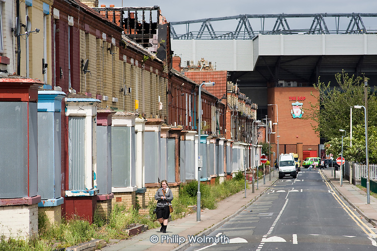 Tinned up houses in Venmore Street, Anfield, leading to the Kop at Liverpool football stadium.  Several neighbouring streets are scheduled for demolition by the Merseyside NewHeartlands partnership, financed by the Housing Market Renewal Fund, part of a government strategy aimed at tackling 'low demand'.  Some long-standing residents oppose the demolition of their homes.