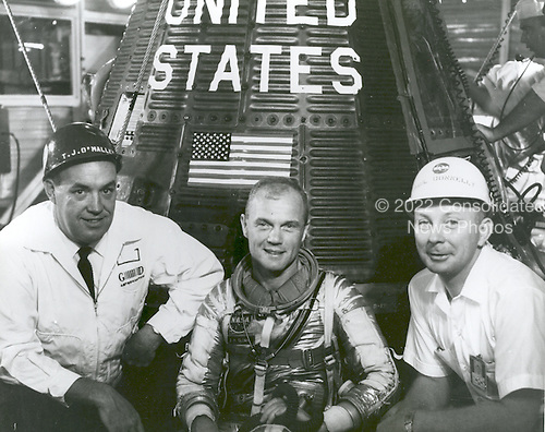 "Grouped together with astronaut John H. Glenn, Jr., beside ""Friendship 7"" spacecraft are left to right: T.J. O'Malley, chief test conductor for General Dynamics; Glenn; and Paul Donnell at Cape Canaveral, Florida on January 24, 1962..Credit: NASA via CNP"
