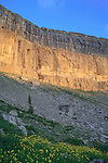 The sun spot lights part of the Chinese Wall at sunrise in Montana