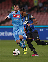 Napoli's    Goran Pandev challenge inter's  Alvaro Pereira fight for the ball during their Italian Serie A soccer match at the San Paolo stadium in Naples.  NAPOLI 05/05/2013 -.CALCIO SERIE A 2012/2013 . NAPOLI - INTER - .NELLA FOTO  GORAN PANDEV ALVARO PEREIRA.FOTO CIRO DE LUCA
