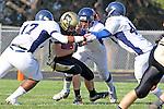 Palos Verdes CA 10/22/10 - Josh Mcguiness (Peninsula #3),Cheyanne Bates (Leuzinger #17), Omar Bucio (C) (Leuzinger #44) in action during the Leuzinger - Peninsula varsity football game at Palos Verdes Peninsula High School.