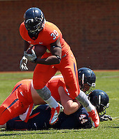 Virginia running back LaChaston Smith (30) runs the ball during the annual Virginia football Orange-Blue Spring Game Saturday at Scott Stadium in Charlottesville, VA. Photo/The Daily Progress/Andrew Shurtleff