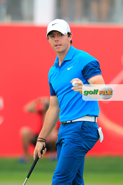 Rory McIlroy (NIR) takes his putt on the 18th green during Sunday's Final Round of the Abu Dhabi HSBC Golf Championship 2015 held at the Abu Dhabi Golf Course, United Arab Emirates. 18th January 2015.<br /> Picture: Eoin Clarke www.golffile.ie