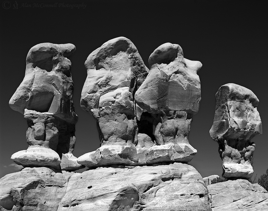 &ldquo;The Four Wise Men&rdquo;<br /> Devils Garden, Grand Staircase- Escalante, Utah<br /> 2014<br /> <br /> The Grand Staircase-Escalante National Monument consists of many wonderful geologic features, such as plateaus, mesas, buttes, canyons, and pinnacles.  One such area is called the Devils Garden.  It can be found by driving 12 miles down the unpaved Hole-in-the-Rock Road.  The Devils Garden has no marked trails, but it is an easy place to explore many interesting sandstone formations including arches and hoodoos.  One group of four hoodoos is referred to as The Four Wise Men.  <br /> <br /> 4 x 5 Large Format Film<br /> Delta 100 film<br /> 210 mm lens